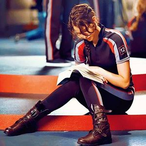 This picture of Katniss (Jennifer Lawrence) reading Harry Potter says it all.