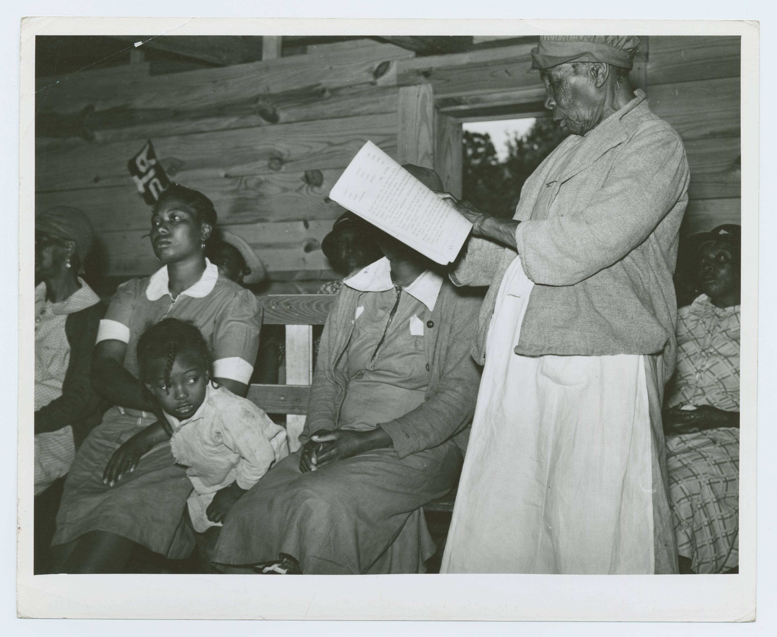 Star pupil, 82 years old, reading her lesson in adult class, Gee's Bend, Alabama, May 1939 - Marion Post Wolcott