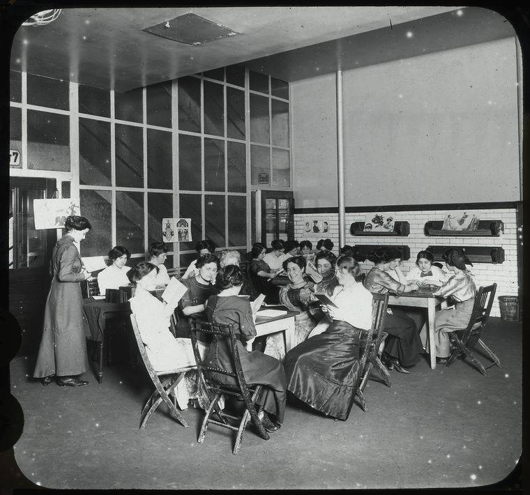 Young women around tables reading, P.S. 63, Recreation Center, May 1911 - Lewis Wickes Hine
