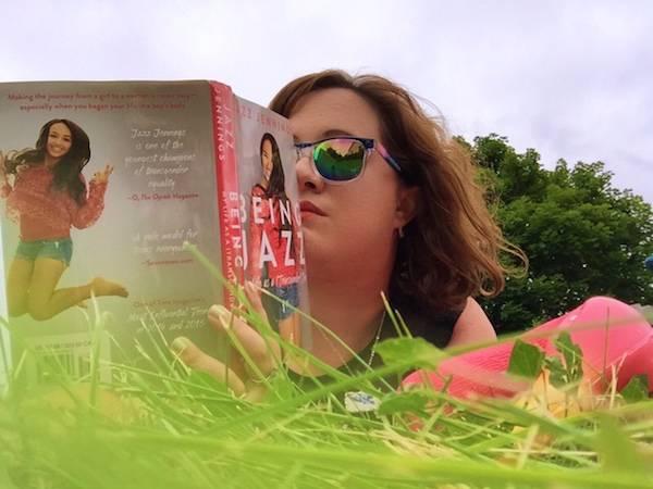 outside lying down reading