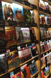 A wall of shelves containing graphic novels with their covers facing outward