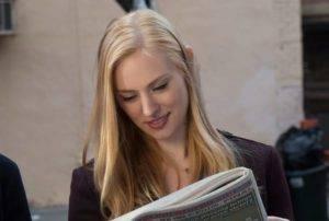 Karen Page (played by Deborah Ann Moll) is reading a newspaper