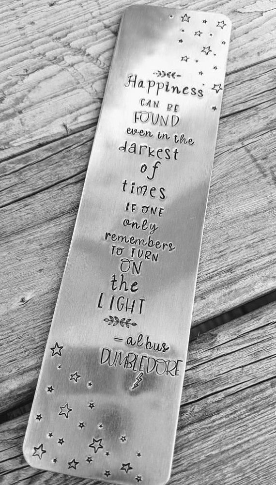 Happiness can be found in even the darkest of times Dumbledore quote hand stamped metal bookmark