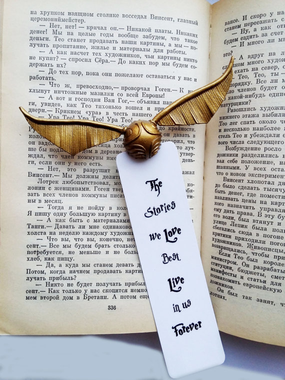 golden snitch bookmark with quote the stories we love best live in us forever