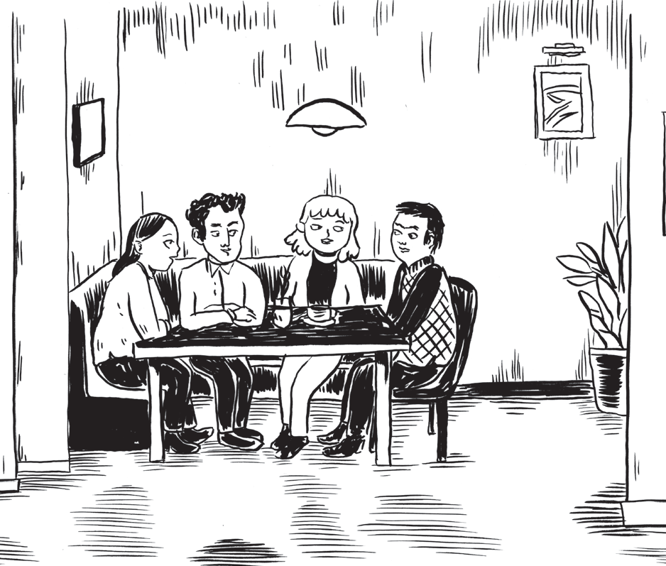 Four people seated in a restaurant booth