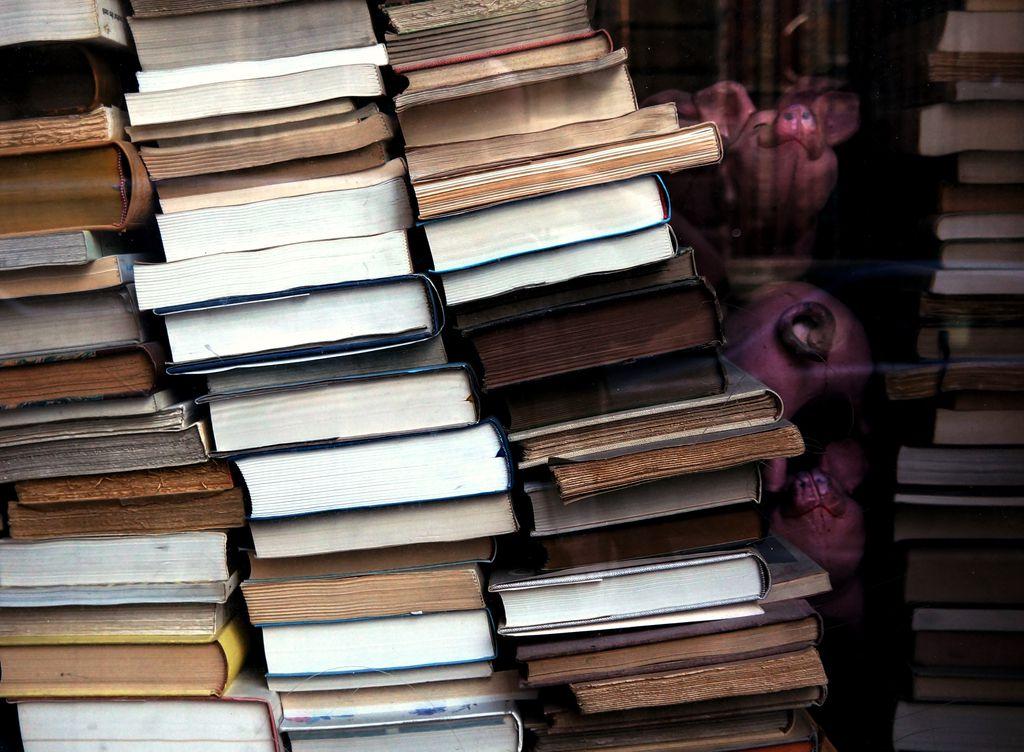 Photo of book stacks by Ali Bong via Unsplash