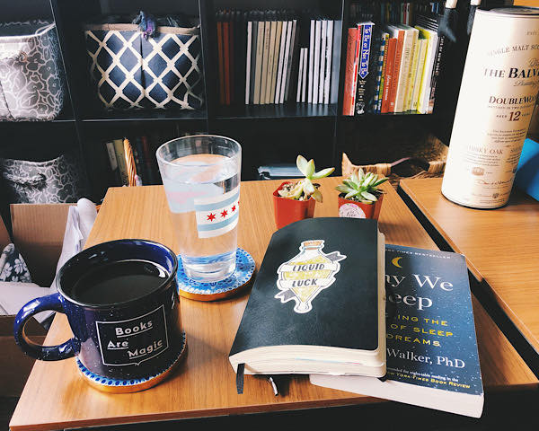 The Book Why We Sleep and my journal, with coffee and plants
