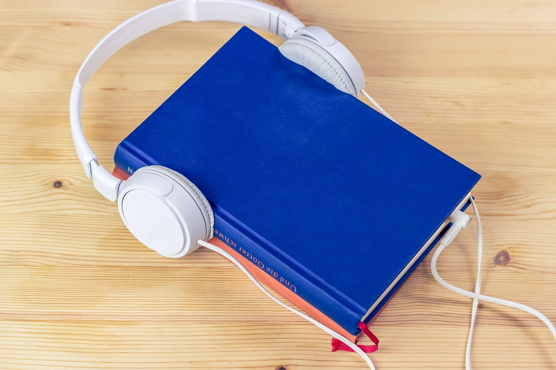 A book with headphones on it