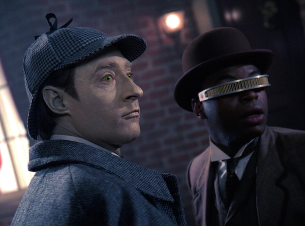 Commander Data and Lt. Geordi La Forge dressed as Holmes and Watson. Image source: https://memory-alpha.fandom.com/wiki/Elementary,_Dear_Data_(episode)
