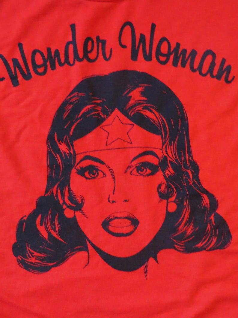 http://www.awin1.com/cread.php?awinmid=6220&awinaffid=258769&clickref=&p=https://www.etsy.com/listing/704436632/wonder-woman-tank-t-shirt-dc-comics-red